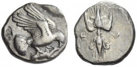 Elis, Olympia. Stater circa 450-440 BC, AR 11.46 g. Eagle flying r., grasping rabbit with its talons and its beak. Rev. F – A Thunderbolt with volutes...