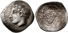 SICILY. Naxos. Circa 420-403 BC. Litra (Silver, 12 mm, 0.56 g, 1 h). [ΝΑΧΙΩΝ] Youthful head of Dionysos to left, wearing ivy-wreath. Rev. Bunch of gra...