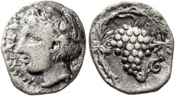SICILY. Naxos. Circa 420-403 BC. Litra (Silver, 11 mm, 0.83 g, 1 h). ΝΑΧΙΩΝ Youthful head of Dionysos to left, wearing ivy-wreath. Rev. Bunch of grape...