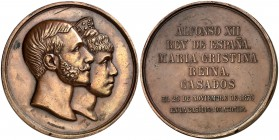 1879. Alfonso XII. Casamiento Real. (V. 487) (V.Q. 14400). 254 g. 71 mm. Bronce. Firmado: G. Sellán. Leves golpecitos. Escasa. MBC+.