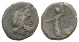 Sicily, Syracuse. Roman rule, after 212 BC. Æ (22mm, 7.67g, 10h). Laureate head of Zeus r. R/ Tyche standing l., holding rudder and sceptre; prow to r...