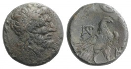 Macedon, Paroreia, c. 185-168 BC. Æ (14.5mm, 3.46g, 6h). Laureate head of Zeus r. R/ Eagle standing on thunderbolt right, head reverted; two monograms...