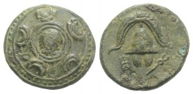 Kings of Macedon. Anonymous, after 311 BC. Æ (16mm, 3.49g, 1h). Macedonian shield, in centre head of Herakles in lionskin. R/ Macedonian helmet; monog...