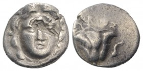 Central Greece, Uncertain, c. 190-170 BC. AR Drachm (14mm, 2.65g, 12h). Pseudo-Rhodian type. Head of Helios facing slightly r.; c/m: lion standing r. ...