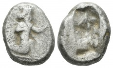 Achaemenid Empire. Time of Darios I to Xerxes II 485-420 BC. AR Siglos (16mm, 5.53g). Persian king or hero in kneeling-running stance right, holding s...