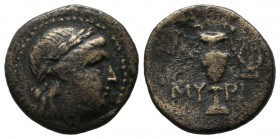 Aeolis, Myrina. Circa 2nd-1st century BC. AE Dichalkon (16mm, 3.24g). Laureate head of Apollo to right / MY-PI Amphora; to right, lyre. SNG Copenhagen...