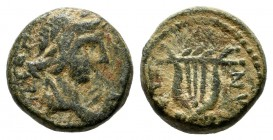 Aeolis, Myrina. Pseudo-autonomous, 2nd. century AD. AE (11mm, 1.77g). Laureate and draped bust of Apollo right / Lyre within dotted circle.