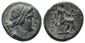 Asia Minor, uncertain mint. Circa 4th-3rd centuries BC. AE (16mm, 4.54g). Female head right. / […]KEΩN, Figure seated right on chair, holding uncertai...