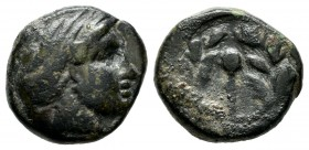 Asia Minor? Uncertain. Circa 4th - 3rd century BC. AE (14mm, 3.35g). Male or female head right. / Uncertain figure (Thyrsos?); all within wreath.