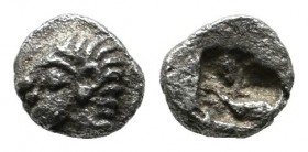 Ionia, Kolophon. Circa 525-500 BC. AR Tetartemorion (4mm, 0.19g). Archaic head of Apollo left / Incuse square punch. SNG Kayhan 343; SNG von Aulock 18...
