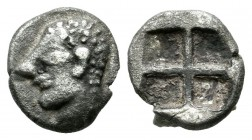 Ionia, Kolophon. Circa 600 BC. AR Obol (9mm, 0.88g). Archaic male head (of Apollo?) left / Quadripartite incuse square. Cf. SNG Kayhan 342 (hemiobol) ...