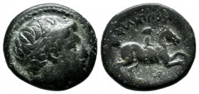 Kings of Macedon. Philip II. 359-336 BC. AE unit (17mm, 5.24g). Uncertain Macedonian mint. Head of Apollo right, waering tainia / ΦIΛIΠΠOY, youth on h...