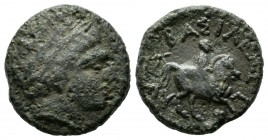 Kings of Thrace. Lysimachos (As King) 306-281 BC. AE unit (16mm, 4.23g). Lysimacheia mint. Laureate head of Apollo right / BAΣIΛEΩΣ, youth on horsebac...