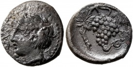 SICILY. Naxos. Circa 420-403 BC. Litra (Silver, 10 mm, 0.78 g, 3 h). [ΝΑΧΙΩΝ] Youthful head of Dionysos to left, wearing ivy-wreath. Rev. Bunch of gra...