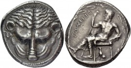 Bruttium, Rhegium. Tetradrachm circa 435-425, AR 17.46 g. Lion's mask facing. Rev. RECINOS Apollo Iocastus seated l., himation over lower limbs; r. ha...