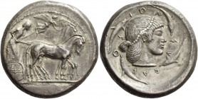 Syracuse. Tetradrachm circa 482, AR 17.02 g. Slow quadriga driven r. by charioteer, holding kentron and reins; above, Nike flying r. to crown horses. ...