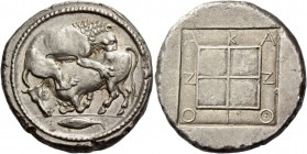 Macedonia, Acanthus. Tetradrachm circa 430-400, AR 17.26 g. Bull crouching to l., attacked by lion leaping on its back to r.; beneath, fish l. Rev. ΑΚ...