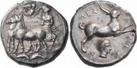 SICILY. Messana. Circa 411-408 BC. Tetradrachm (Silver, 24 mm, 16.86 g, 2 h). The nymph Messana, wearing chiton and standing left with the reins in bo...
