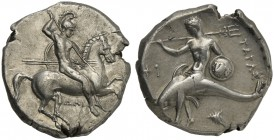 Apulia, Tarentum, Nomos, ca. 332-302 BC; AR (g 7,84; mm 21; h 8); Horseman galloping r., holding shield and spears; below, ΔAI, Rv. TAPAΣ, dolphin rid...