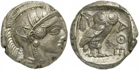 Attica, Athens, Tetradrachm, after 449 BC; AR (g 17,22; mm 24; h 12); Head of Athena r., wearing crested Attic helmet decorated with three olive leave...