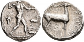 BRUTTIUM. Kaulonia. Circa 475-425 BC. Didrachm or Nomos (Silver, 19 mm, 7.78 g, 10 h). Apollo, nude, advancing to right, with a laurel branch in his u...