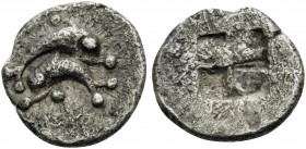 ISLANDS OFF THRACE, Thasos. Circa 435-411 BC. Obol (Silver, 9 mm, 0.55 g). Two dolphins above one another, swimming in opposite directions; pellet abo...