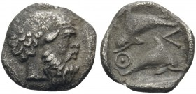ISLANDS OFF THRACE, Thasos. Circa 411-404 BC. Hemiobol (Silver, 9 mm, 0.44 g, 5 h). Bald and bearded head of satyr to right. Rev. ΘΑΣ Two dolphins, on...