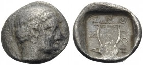 MACEDON. Akanthos. Circa 390-382 BC. Obol (Silver, 9 mm, 0.42 g, 12 h). Head of Apollo to right, wearing taenia. Rev. AK-ANΘ-ION Kithara with seven st...
