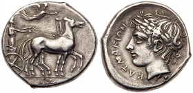"Sicily, Katane, Silver Tetradrachm (17.18 g, 2h). 415-410 BC. Dies engraved by the ""Master of the leaf"". Charioteer, wearing a long chiton and holding..."