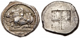Macedonia, Akanthos. AR Tetradrachm (17g), ca. 470 BC. Lion right attacking bull kneeling left, above Θ, below triple exergual line, bucranim. R...