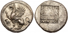 Thrace, Abdera. Silver Tetradrachm (14.35 g), ca. 450-425 BC. Pythinnes, magistrate. Griffin seated left with forepaw raised; in left field, hand, E&P...