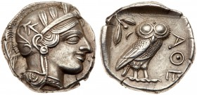 Attica, Athens, Silver Tetradrachm (17.10 g, 9h) 454-404 BC. Head of Athena facing right, wearing a crested Attic helmet decorated with three olive-le...