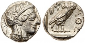 Attica, Athens. Silver Tetradrachm (17.14 g), ca. 454-404 BC. Helmeted head of Athena right, frontal eye. Reverse: AΘE, owl standing right, head...