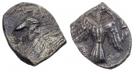 Judaea, Yehud (Judah). Silver 1/2 Gerah (0.25 g), before 333 BCE. Head of Persian king right, wearing jagged crown. Rev. 'YHD', falcon with wings spre...