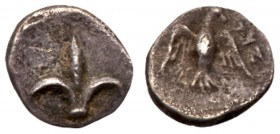 Judaea, Yehud (Judah). Silver 1/2 Gerah (0.45 g), ca. 375-332 BCE. Lily. Rev. 'YHD' (Yehud), falcon with wings displayed, head turned to right. Hendin...