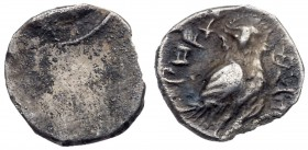 Judaea, Yehud (Judah). Hezekiah. Silver 1/2 Ma'ah Obol (0.27 g), ca. 333/2-302/1 BCE. Facing head within beaded circular border. Rev. 'HPHH YHZQYH' (Y...