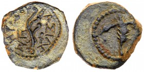 Judaea, Herodian Kingdom. Herod I. Æ Prutah (2.54 g), 40-4 BCE. Uncertain mint in Samaria, RY 3(38/7 BCE). Palm branch with objects (leaves?) to...