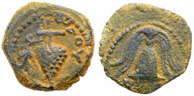 Judaea, Herodian Kingdom. Herod II Archelaus. Æ Prutah (2.10 g), 4 BCE-6 CE. Jerusalem. Grape bunch on vine. Rev. Crested helmet; in left field,...