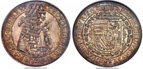 Leopold I Taler 1699 MS64 NGC, Hall mint, KM1303.5, Dav-3245A. Exceptionally alluring, with a forceful combination of superior strike and color, both ...