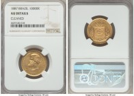 Pedro II gold 10000 Reis 1887 AU Details (Cleaned) NGC, KM467. An attractive type with minimal signs of rub on the highpoints. From the Grand Castello...