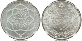 Abd al-Hafiz 1/2 Rial AH 1329 (1911) MS65 NGC, Paris mint, KM-Y24. A resplendent gem and displaying an unrivaled quality for the type. Currently none ...