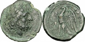 Greek Italy. Bruttium, Brettii. AE unit, 214-211 BC. D/ Laureate head of Zeus right; behind, ear of corn. R/ Eagle standing left on thunderbolt, wings...