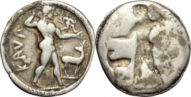Greek Italy. Bruttium, Kaulonia. AR Stater, 525-500 BC. D/ Apollo standing right; holding branch in right hand; on extended left arm small figure carr...