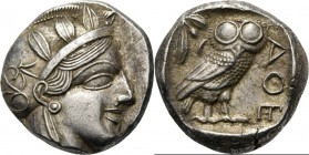 AR Tetradrachm ca. 430–415 BC, Attica, ATHENS Head of Athena right, wearing crested helmet ornamented with three olive-leaves and floral scroll. Rev. ...