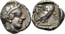 AR Tetradrachm 449–413 BC, Attica, ATHENS Head of Athena right, wearing crested helmet ornamented with three olive-leaves and floral scroll. Rev. owl,...