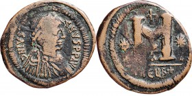 Æ Follis , JUSTINIANUS I 527–565 Mint of Antioch / Theoupolis. Diademed, draped and cuirassed bust right. Rev. large M between stars, cross above, ben...