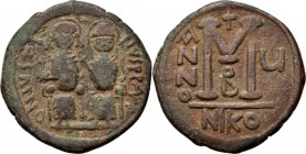 Æ Follis 569-570 AD, JUSTINUS II 565–578 Nicomedia. Justinus left and Sophia right seated facing on double throne, both nimbate. He holds globus cruci...