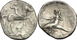 Greek Italy. Southern Apulia, Tarentum. AR Nomos, 280-272 BC. D/ Horseman right, crowning himself; below, capital. R/ Phalantos riding on dolphin left...