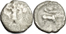 Greek Italy. Southern Lucania, Sybaris. AR Triobol, 453-448 BC. D/ Poseidon striding right, hurling trident, drapery falling from forward arm. R/ Bull...