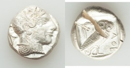 ATTICA. Athens. Ca. 455-440 BC. AR tetradrachm (23mm, 17.23 gm, 1h). XF, test cut. Early transitional issue. Head of Athena right, wearing crested Att...